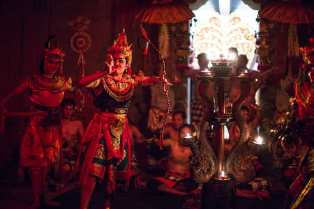 UBUD, BALI  INDONESIA - FEB 27, 2016: Unidentified dancers performing traditional balinese Kecak Trance Fire Dance. Kecak (also known as Ramayana Monkey Chant) is very popular cultural show on Bali. Editorial