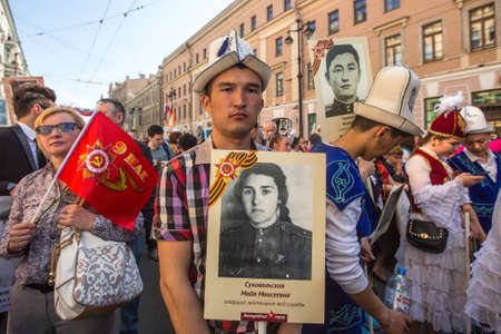 immortal: St.PETERSBURG, RUSSIA - MAY 9, 2016: Participants of Immortal Regiment - public action, during which participants carried portraits of their relatives who participated in Great Patriotic War.