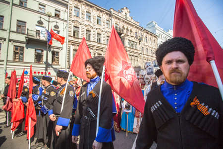 initiated: St.PETERSBURG, RUSSIA - MAY 9, 2016: March of Immortal Regiment, timed to 71st anniversary of the Victory in the great Patriotic war. Action in its present form was initiated in Tyumen in May 2007.