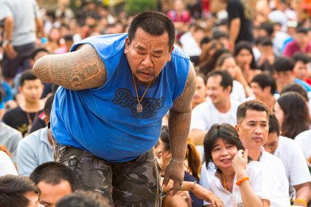 possession: WAT BANG PHRA, THAILAND - MAR 19, 2016: Unknown participants of Master Day Ceremony at able Khong Khuen (spirit possession) during the Wai Kroo ritual at Bang Pra monastery, about 50 km of Bangkok. Editorial
