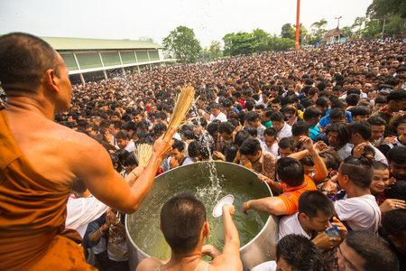 WAT BANG PHRA, THAILAND - MART 19, 2016: Blessing with Holy water of participants Wai Kroo (Luang Por Phern) Master Day Ceremony at Wat Bang Phra monastery, about 50 km of Bangkok.