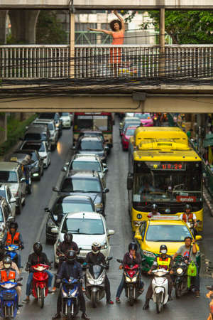 annually: BANGKOK, THAILAND - MAR 30, 2016: Transport traffic in city centre. Annually an estimated 150,000 new cars join the heavily congested roads of Bangkok. Editorial