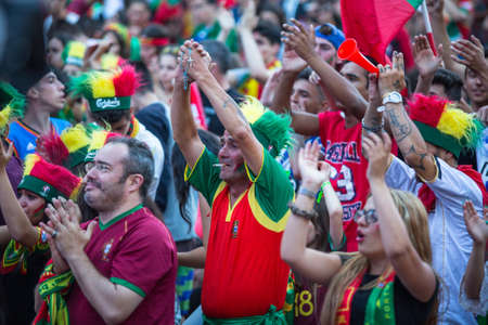 occurrence: PORTO, PORTUGAL - JUL 10, 2016: Portuguese fans during video translation of the football match Portugal - France final of the European championship 2016, in Liberdade Square at city center of Porto.