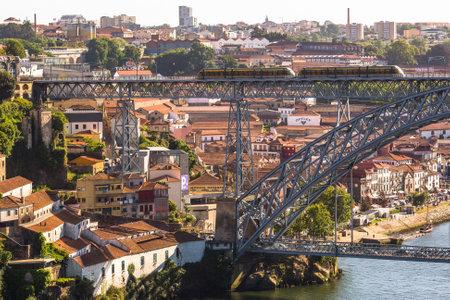 6 12: PORTO, PORTUGAL - JUL 12, 2016: Train of Porto Metro on Dom Luis iron Bridge in Old Town. The network has 6 lines and reaches seven municipalities within the metropolitan Porto area.