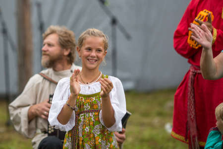annually: GRISHINO, RUSSIA - JUL 30, 2016: Unidentified participants of the Festival of folk culture Russian Tea. Festival held annually in Grishino ecovillage since 2012.