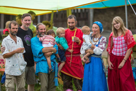 ecovillage: GRISHINO, RUSSIA - JUL 30, 2016: Unidentified residents of ecovillage. As an alternative to industrial civilization, they offer life in small communities with minimal impact on nature, from 50 to 150 inhabitants.