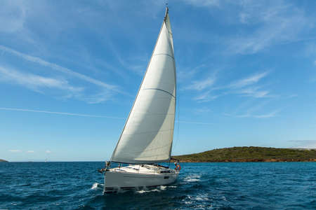 Sailing ship yachts with white sails in the Aegean Sea. Luxury cruise boats.