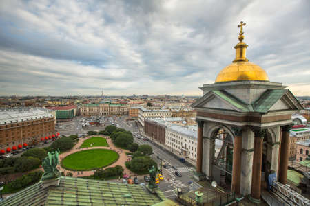 19 years: St.PETERSBURG, RUSSIA - AUG 19, 2016: Top view from the colonnade of St.Isaacs Cathedral. Is the largest Russian Orthodox cathedral (sobor) in the city, took 40 years to construct, from 1818 to 1858.