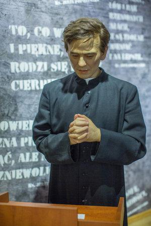 martyr: KRAKOW, POLAND - SEP 9, 2016: Jerzy Popieluszko (Polish Roman Catholic priest, Martyr of the Catholic Church) wax figure of Polonia Wax Museum at Main Market Square.
