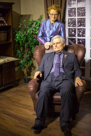 Polonia: KRAKOW, POLAND - SEP 9, 2016: Lech Walesa and his wife Danuta wax figures of Polonia Wax Museum at Main Market Square. The Wax Museum was opened in 2016, inspired by the organization in Krakow World Youth Day.