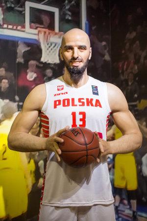 Polonia: KRAKOW, POLAND - SEP 9, 2016: Marcin Gortat (Polish professional basketball player) wax figure of Polonia Wax Museum at Main Market Square.