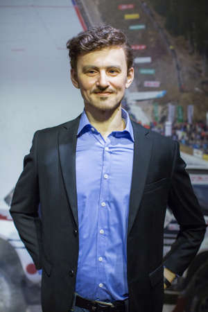 museum rally: KRAKOW, POLAND - SEP 9, 2016:  Adam Malysz (Polish former ski jumper and current rally driver. One of the most successful ski jumpers of all time) wax figure of Polonia Wax Museum at Main Market Square. Editorial