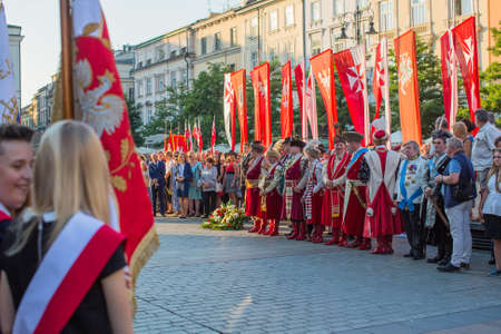 KRAKOW, POLAND - SEP 10, 2016: Unidentified participants of ceremony is the vow of first classes of the Jan III Sobieski High School (founded in 1883) at the Main Market Square near St.Mary Cathedral. Editorial