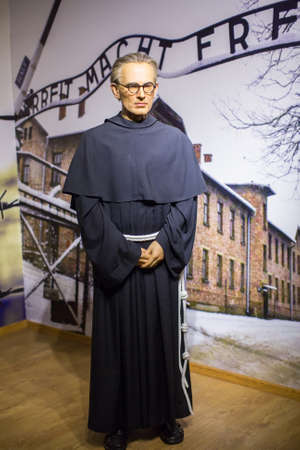 KRAKOW, POLAND - SEP 9, 2016: Maximilian Kolbe (Polish Conventual Franciscan friar) wax figure of Polonia Wax Museum at Main Market Square. The Wax Museum was opened in 2016, inspired by the organization in Krakow World Youth Day.