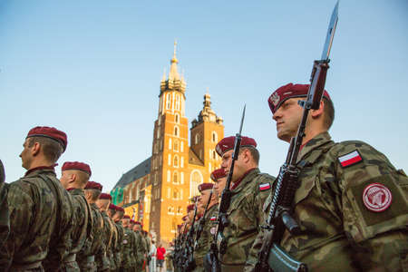KRAKOW, POLAND - SEP 10, 2016: Polish soldiers on guard of the ceremony is the vow of first classes of the Jan III Sobieski High School (founded 1883) at the Main Market Square near St.Mary Cathedral. Editorial
