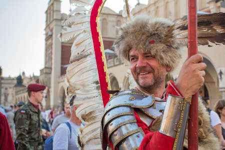 sobieski: KRAKOW, POLAND - SEP 10, 2016: Polish military in historical costumes during ceremony is the vow of first classes of the Jan III Sobieski High School at the Main Market Square near St.Mary Cathedral. Editorial
