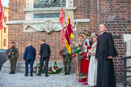 sobieski: KRAKOW, POLAND - SEP 10, 2016: Unidentified participants of ceremony is the vow of first classes of the Jan III Sobieski High School (founded in 1883) at the Main Market Square near St.Mary Cathedral. Editorial