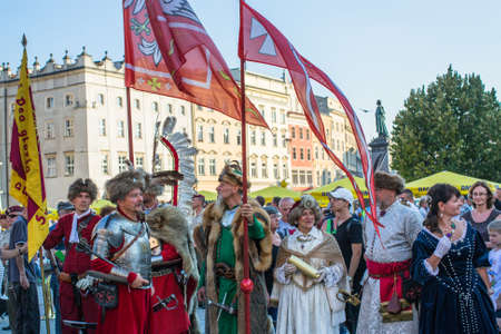 sobieski: KRAKOW, POLAND - FEB 10, 2016: Polish military in historical costumes during ceremony is the vow of first classes of the Jan III Sobieski High School at the Main Market Square near St.Mary Cathedral.