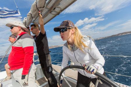 MILOS, GREECE - SEP 26, 2016: Sailors participate (Monte-Cristo team) in sailing regatta 16th Ellada Autumn 2016 among Greek island group in the Aegean Sea, in Cyclades and Saronic Gulf.