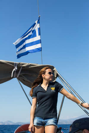 ERMIONI, GREECE - SEP 28, 2016: Russian sailors participate in sailing regatta 16th Ellada Autumn 2016 among Greek island group in the Aegean Sea, in Cyclades and Saronic Gulf. Editorial