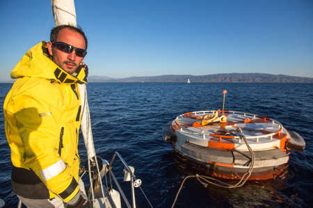 sep: POROS, GREECE - SEP 29, 2016: Sailors participate in sailing regatta 16th Ellada Autumn 2016 among Greek island group in the Aegean Sea, in Cyclades and Saronic Gulf.