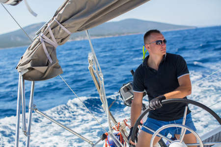 Russian yachtsman during in the race, sailing the Aegean sea.