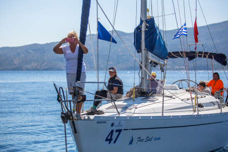 POROS, GREECE - SEP 29, 2016: Sailors participate in sailing regatta 16th Ellada Autumn 2016 among Greek island group in the Aegean Sea, in Cyclades and Saronic Gulf.