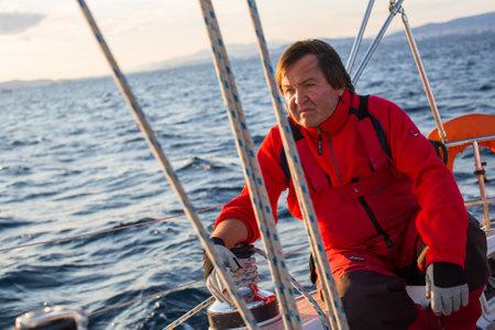 participate: ATHENS, GREECE - SEP 24, 2016: Sailors participate in sailing regatta 16th Ellada Autumn 2016 among Greek island group in the Aegean Sea, in Cyclades and Saronic Gulf.