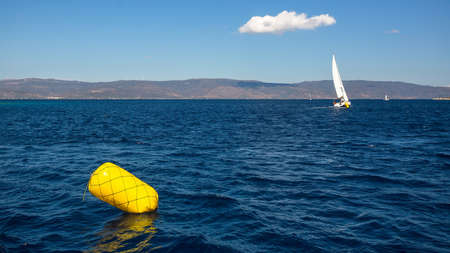 Finish line buoy at sailing sea yacht race regattas. Luxery vacations, adventure, travel. Stock Photo