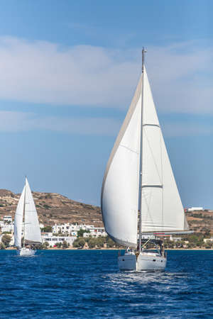greek islands: Sailing regatta among Greek islands in Aegean Sea. Stock Photo