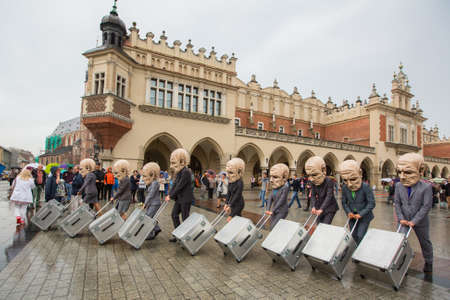 KRAKOW, POLAND - SEP 17, 2016: Participants of Krakow Theatre Night festival -KTO Teatre (Peregrinus, written and directed by J.Zon) in Main Market Square. Entry to all shows of Theatre Night is free. Editorial