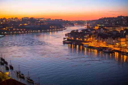 dom: Douro River at Porto by night, Portugal.