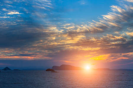 Stunning sunset among Islands in the Aegean sea.