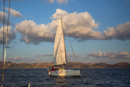 MILOS, GREECE - SEP 27, 2016: Sailors participate in sailing regatta 16th Ellada Autumn 2016 among Greek island group in the Aegean Sea, in Cyclades and Saronic Gulf.