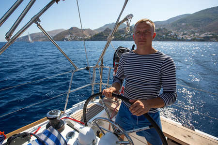 yachtsman: Yachtsman during in the boat race, sailing the Aegean sea. Stock Photo