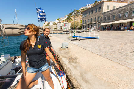 bateau de course: HYDRA, GREECE - SEP 28, 2016: Sailors participate in sailing regatta 16th Ellada Autumn 2016 among Greek island group in the Aegean Sea, in Cyclades and Saronic Gulf.