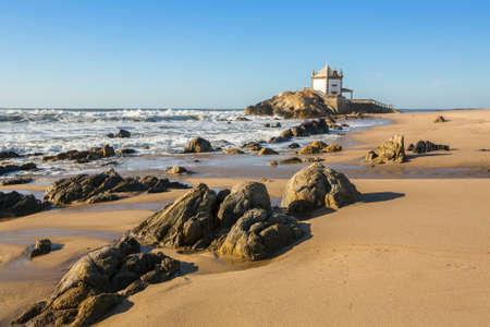 Praia de Miramar (Miramar Beach) ? and the small chapel called Senhor da Pedra (Lord of the Rock), Arcozelo, Vila Nova de Gaia, big Porto, Portugal. Stock Photo