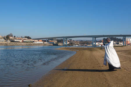 baptizing: PORTO, PORTUGAL - JAN 19, 2017: Celebrating Baptism of Jesus in the Parish of Russian Orthodox Church near Douro river. This is one of the holiest holidays for all Christians. Editorial