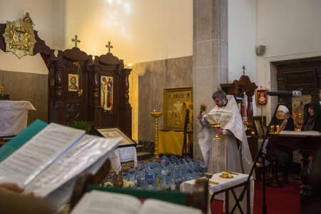 baptizing: PORTO, PORTUGAL - JAN 19, 2017: During celebrating Baptism of Jesus in the Parish of Russian Orthodox Church. This is one of the holiest holidays for all Christians.