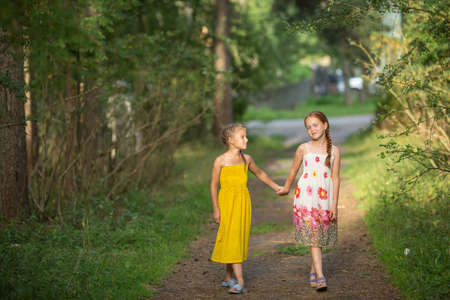 go for: Two little girls go for the handle on the green alley. Stock Photo
