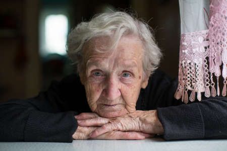 75s: Closeup portrait of elderly woman looking at the camera. Stock Photo
