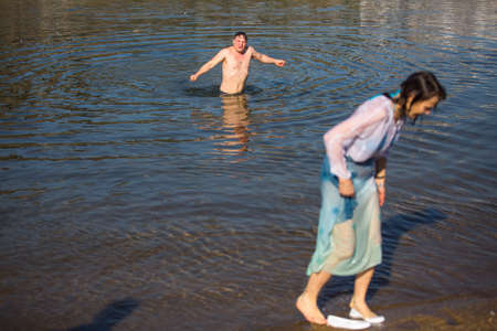 baptizing: PORTO, PORTUGAL - JAN 19, 2017: Celebrating Baptism of Jesus and Epiphany bathing in Douro river in the Parish of Russian Orthodox Church. This is one of the holiest holidays for all Christians.