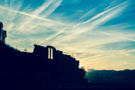 abandoned building: Silhouette of abandoned building against the blue sky at dusk. Stock Photo