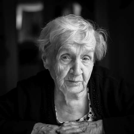 Black and white portrait of an elderly woman.