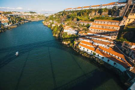 Top views of Douro river and coast Villa Gaia de Nova from the Dom Luis I iron Bridge, Porto, Portugal.