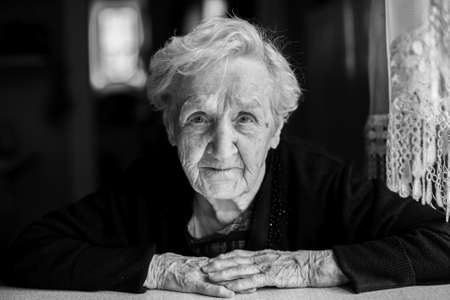 blackandwhite: Black and white contrast portrait of an elderly woman.