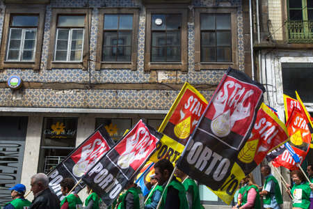 soviet flag: PORTO, PORTUGAL - MAY 1, 2017: Celebration of May Day in the Oporto centre. General Confederation of Portuguese workers, traditionally associated with the Communist party, has 800.000 members. Editorial