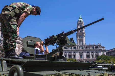PORTO, PORTUGAL - JUNE 7, 2017: Unidentified people during a public demonstration of the military equipment in the central square of the city. Editorial