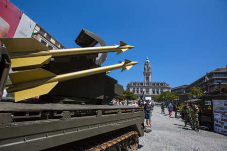 PORTO, PORTUGAL - JUNE 7, 2017: Unidentified people during a public demonstration of the military equipment in the central square of the city. Editöryel