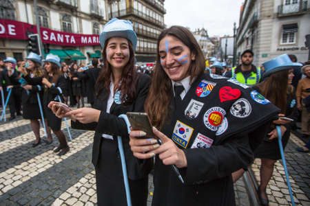 researching: PORTO, PORTUGAL - MAY 9, 2017: Participants of Queima Das Fitas Parade - traditional festivity of students of Portuguese universities. Portos Queima was the first to reborn after the 1974 revolution.